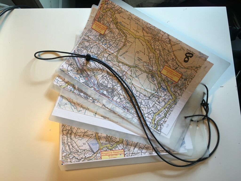 The long route split into 8 laminated map sections.